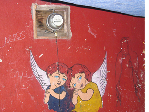 angels and the outline of the Virgin of Guadalupe on a red wall in San Miguel de Allende